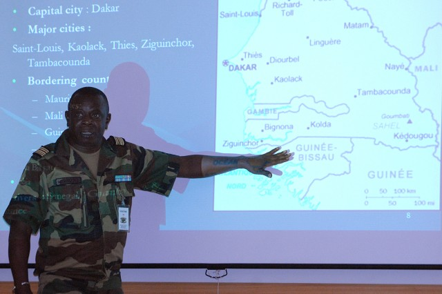 Senegalese Col. Mar Ndoye uses a map to help a group from the Center for Army Lessons Learned understand ongoing political issues around Senegal during a briefing March 17 at CALL, at Fort Leavenworth, Kan.