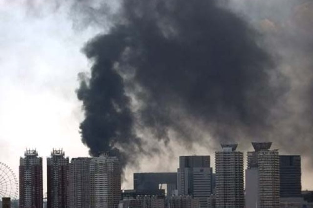 Smoke raises from a building in Tokyo's waterfront March 11. A massive 9.0-magnitude earthquake hit Japan and the subsequent tsunami about 250 miles northeast of Tokyo. Yet, its effects were felt by the 35 million people living in the Tokyo metropolitan area, swaying buildings, causing fires and a great amount of damage, shutting down subways and elevated expressways, and causing a major gridlock throughout the city. The country is now struggling with aftershocks, food and water shortages, and the fears of nuclear disaster.