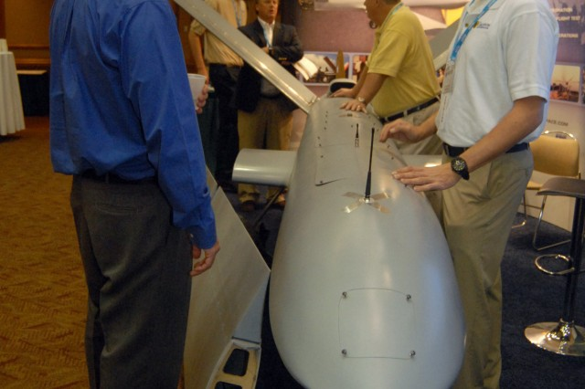 Kent Felten, left, of Bosh Global Service checks out the Broadsword XL exhibit presented by Griffon Aerospace at the Pathfinder Symposium. Greg Cando of Griffon, right, explains the system while Mark Dyess, Merritt Patterson and Gary Tuttle talk in the background.