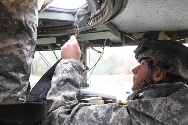 "Spc. Casey Rowland, a Human Intelligence Collector with the 373rd Military Intelligence Battalion, Military Intelligence Readiness Command, offers guidance to the gunner of the vehicle ""Red 5"" during convoy lanes training at Regional Training Center-West (RTC-W) at Fort Hunter Liggett, Calif.  The 373rd was at RTC-W in preparation for deployment in support of Operation New Dawn."