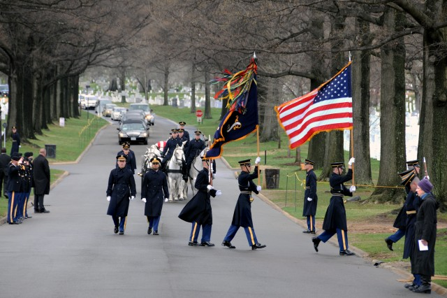 The caisson rolls up with the remains of the four crew members who died together with their fellow airmen.