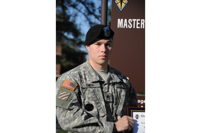Staff Sgt. Brandon Smith, a drill sergeant stationed at Fort Benning, Ga., is the 1,000th student to graduate from the Master Resilience Training Course facility. The school opened April 5, and trains Soldiers and DA civilians to teach resiliency skills in their units and organizations.