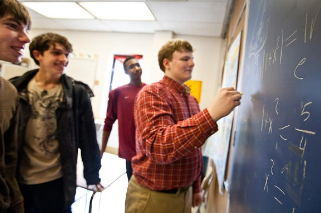 (Right to left:) Meade High School seniors Logan Crew, 17; Edward Glover (background), 17; Michael Yovanovic, 17; and Matthew Wilmes, 17, solve math equations at school. As members of the school's math club, they took first-place overall in the 2010-2011 Anne Arundel County High School Mathematics Competition on March 5 at Anne Arundel Community College.
