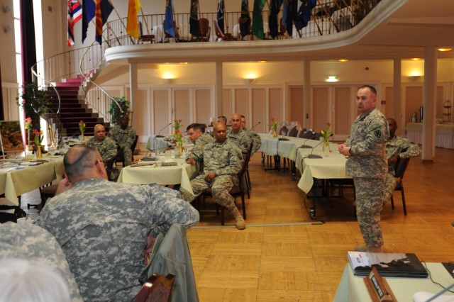 Command Sgt. Maj. James E. Spencer, the senior enlisted advisor for the 21st Theater Sustainment Command, addresses his fellow sergeants major during a 21st TSC sergeants major offsite conference at the Rhinelander Club in Baumholder, Germany, March 13-15.