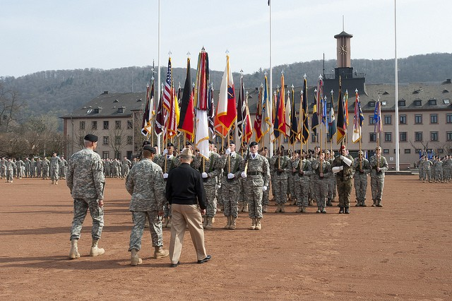 Lt. Gen. Mark Hertling, left, Command Sergeant Major Thomas Capel, center, and Admiral James Stavridis, right, commander of U.S. European Command, walk out to begin the passing of the flag ceremony during Hertling's formal assumption of command of U.S. Army Europe. The ceremony was held at Heidelberg's Campbell Barracks on March 25. U.S. Army photo by Rick Bumgardner.""