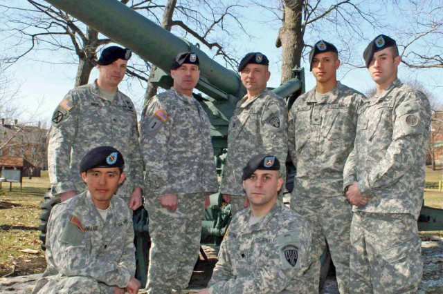 Some of the New York Army National Guard Soldiers chosen to compete in the South African National Defense Force 2011 Regional Combat Rifle Competition pose at Watervliet Arsenal, N.Y., after fulfilling requirements for the trip. Standing, left to right: Staff Sgt. Dennis Rick, of Staten Island, N.Y.; Sgt. Maj. Anthony Coluccio, of Rotterdam, N.Y.; Sgt. First Class Arthur Evans, an alternate, of Saugerties, N.Y.; Spc. Matthew Melendez, of New York City; Cpl. Jonathan Patton, of Brooklyn. Kneeling, left to right: Spc. Masami Yamakado, of New York City and Spc. Jason Grossman of Airmont, N.Y. Other Soldiers who are part of the team were not available for the photograph.