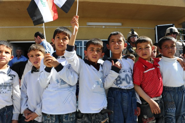School children observe the festivities during the al Duwaya Primary School's opening ceremony in northern Baghdad, March 20. A project was undertaken more than a year ago to refurbish the school, which had fallen into disarray while used as a combat outpost at the height of the 2007 troop surge.