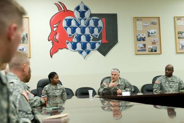 """Chief of Staff of the Army Gen. George Casey Jr., left, talks with 1st Infantry Division Soldiers during a sensing session March 24, at Fort Riley, Kan., about the """"Don't Ask, Don't Tell"""" repeal training."""