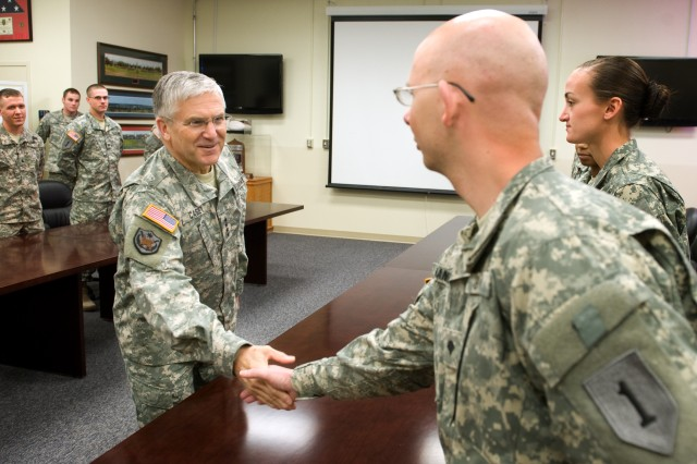 """Chief of Staff of the Army Gen. George Casey Jr., left, shakes hands with a 1st Infantry Division Soldier during a sensing session March 24, at Fort Riley, Kan., about """"Don't Ask, Don't Tell"""" repeal training."""