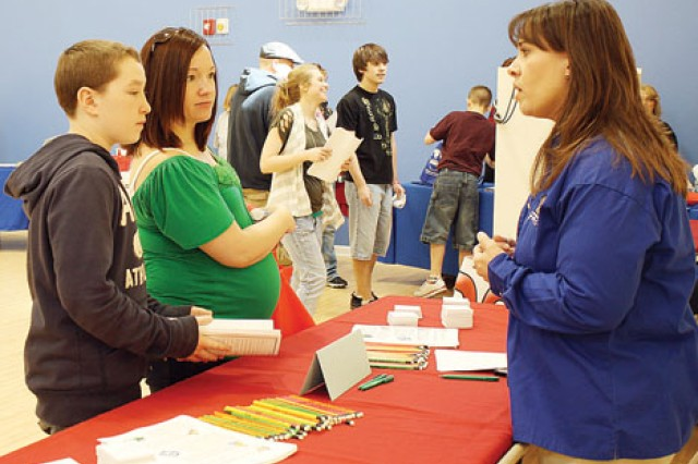 Kyle Doughall, 14, and his mother, Jessica Rhodes, left, talk to Tricia Gowen, public services director, City of Junction City, Kan., right, March 12 about job opportunities during the Youth Job Fair and Volunteer Opportunities event at the Forsyth East CDC at Fort Riley, Kan.