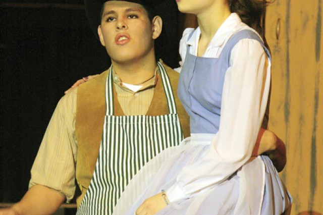 """Maurice and Belle, portrayed by senior Marvin Palacios Jr., and freshman Taylor Collette, perform """"No Matter What"""" during rehearsal of JCHS Performing Arts' presentation of """"Beauty and the Beast"""" March 15 in the school auditorium."""