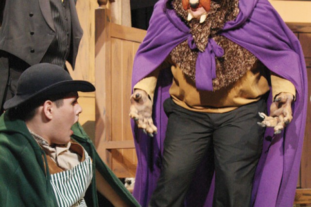 """Maurice, portrayed by senior Marvin Palacios Jr., foreground left, tries to get away from the Beast, portrayed by senior Zan Bertolino, right, during rehearsal of the Junction City High School\'s Performing Arts' presentation of """"Beauty and the Beast"""" March 15 in the school's auditorium in Junction City, Kan."""