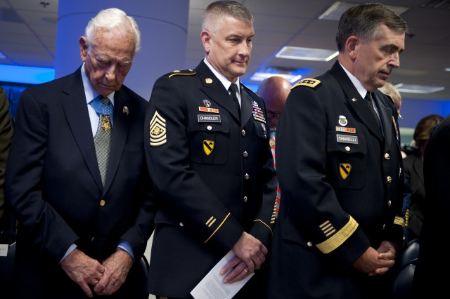 Medal of Honor recipient Walter Ehlers, left, Sergeant Major of the Army Raymond Chandler, center, and Army Gen. Peter Chiarelli, U.S. Army vice chief of staff, pray during the benediction of a ceremony in honor of the 150th anniversary of the Medal of Honor at the Pentagon's Hall of Heroes, Washington, D.C., March 25, 2011.