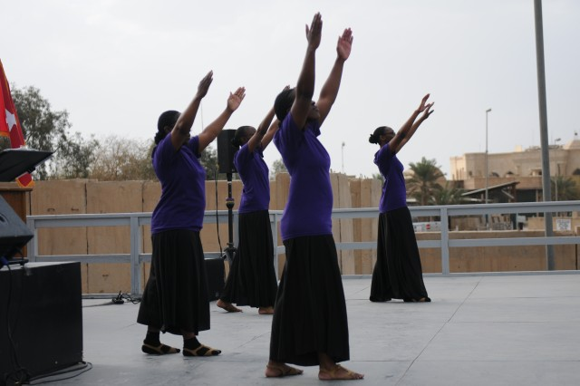 Justice Praise performed a praise dance during the Women's History Month observance on Camp Victory, Iraq, March 24. The Equal Opportunity office hosted this event to commemorate the women in the armed forces.