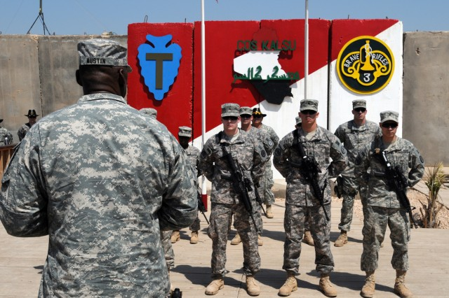 BABIL, Iraq - Gen. Lloyd J. Austin, commander of United States Forces-Iraq, speaks to Soldiers of the 3rd Armored Cavalry Regiment before coining them on Contingency Operating Site Kalsu March 26, 2011. Austin coined the Soldiers for their dedication and outstanding performance and stressed the importance of team recognition. Austin expressed his personal gratitude thanking the Soldiers for what they do on a daily basis for our country. US Army photo by Spc. Adam J. Hefner (110326-A-4813H-001)