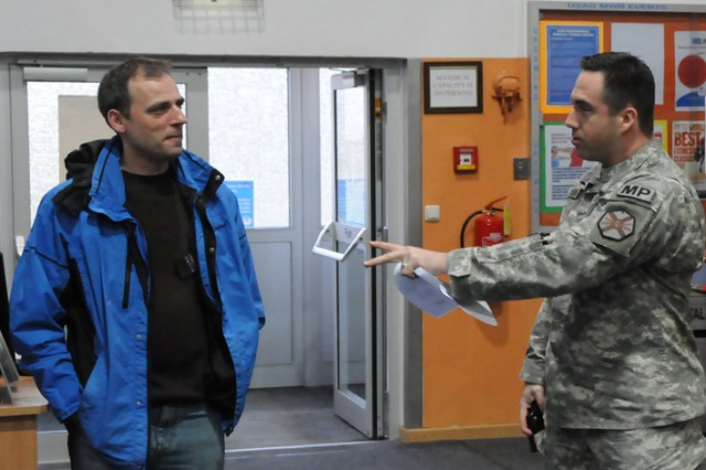 Sgt. 1st Class Lloyd Young and Rose Barracks Fitness Center employee, Peter Bruennig discuss possible scenarios during the workplace violence training offered by the USAG Grafenwoehr Directorate of Emergency Services.