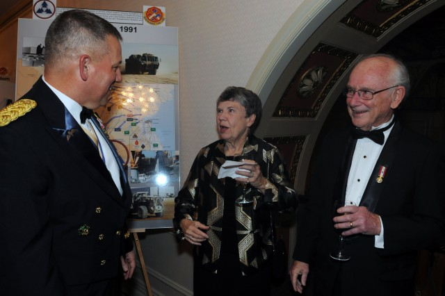 Maj. Gen. Raymond Mason, the U.S. Army Forces Command logistics officer, talks to retired Lt. Gen. Kenneth Lewi, who commanded the 3d Sustainment Command (Expeditionary) from 1981 until 1983, during the 3d ESC's 60th Anniversary Ball March 24 at The Brown Hotel in Louisville, Ky. Maj. Gen. Mason served as Lt. Gen. Lewi's aide-de-camp during his tenure as the unit commander. (U.S. Army photo by Staff Sgt. Rob Strain, 3d Sustainment Command (Expeditionary) Public Affairs.)