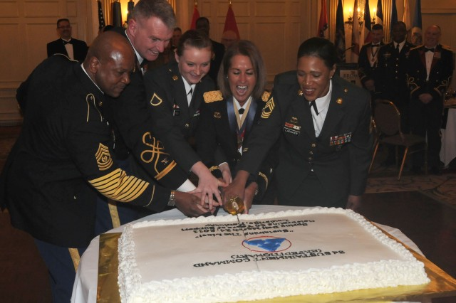 Command Sgt. Maj. Willie C. Tennant, Col. Jarrold Reeves, Private 1st Class Katelynn Neely, Brig. Gen. Robin B. Akin and Master Sgt. Angel Ladaker, cut the ceremonial cake during the 3d ESC's 60th Anniversary Ball on March 24 at The Brown Hotel in Louisville, Ky.  The ball gave those in attendance for the 3d ESC's commander's conference an opportunity to socialize in a relaxed setting while celebrating the 3d ESC's 60th anniversary. (U.S. Army photo by Staff Sgt. Rob Strain, 3d Sustainment Command (Expeditionary) Public Affairs.)