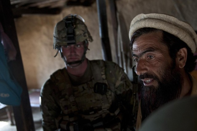 First Lt. Benjamin A. Amsler, a platoon leader assigned to Company B, 2nd Battalion, 327th Infantry Regiment, Task Force No Slack, uses an interpreter to speak to an Afghan villager during a recent operation in the Chowkay district in eastern Afghanistan's Kunar province, March 13. The villager already knew who Amsler was because of his reputation in the area.
