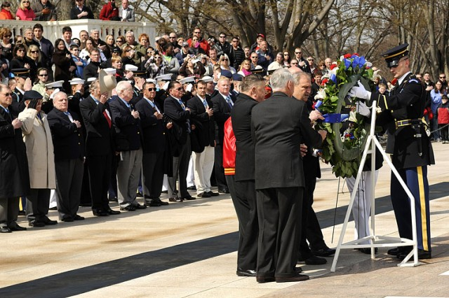 Five Medal of Honor recipients and Commandant of the Marine Corps Gen. James F. Amos lay a wreath at the Tomb of the Unknowns, March 25, in Arlington National Cemetery for National Medal of Honor Day. Other recipients of the award stand behind them.