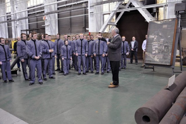 Deputy Commander Ed McCarthy, right, explains the manufacturing process to West Point cadets during their annual visit to the Watervliet Arsenal.