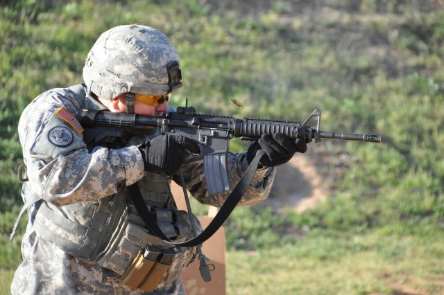 Sgt. 1st Class Daniel Byler, 1-335th Infantry Brigade, Division East-First Army, competes during the combined arms match March 25, at Krilling Range, Fort Benning, Ga. Byler, along with seven other unit members, took part in their first U.S. Army Small Arms Championship this past week.