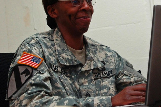 FORT HOOD, Texas - Sgt. 1st Class Elaine Warthen, noncommissioned officer in charge of supply, 589th Brigade Support Battalion, 41st Fires Brigade, checks her email while discussing the path she has taken towards the completion of a doctorate degree in public policy and administration.