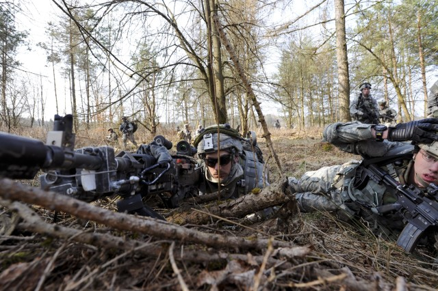 HOHENFELS, Germany - An M240 gunner provides overwatch as Soldiers with U.S. Army Europe's 1st Battalion, 2nd Infantry, 172nd Infantry Brigade, establish a perimeter during an air assault mission at the Grafenwoehr Training Area, March 27. The Soldiers of the 172nd are participating in a Mission Rehearsal Exercise at the Joint Multinational Readiness Center here through April 8. For more photos of the exercise, and other USAREUR images, visit the USAREUR Flickr gallery at www.flickr.com/photos/usareur_images