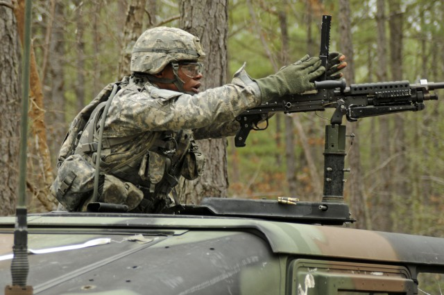 A Soldier from 3rd U.S. Infantry Regiment (The Old Guard) clears the M-240B weapon during a simulated enemy attack at an Expert Infantryman Badge test lane at Fort A.P. Hill, Va., March 21, 2011. Soldiers are tested on their ability to react to several scenarios meant to simulate a deployed environment.