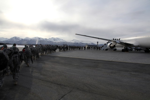 JOINT BASE ELMENDORF-RICHARDSON, Alaska -- Soldiers of the 164th Military Police board their plane March 22 on the Joint Mobility Command flight line here, bound for a yearlong deployment in Afghanistan in Support Operation Enduring Freedom.