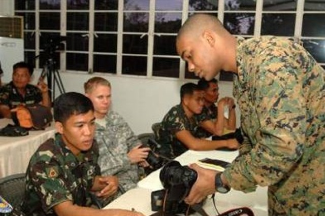 U.S. Marine Cpl. James Anderson, combat videographer at Balikatan 2011, gives classroom instruction to Armed Forces of the Philippines members and U.S Army Soldiers in basic camera operations. Balikatan is a bilateral annual exercise between the Republic of the Philippines and the United States. Training activities enable our soldiers to get to know each other, train together and improve readiness.