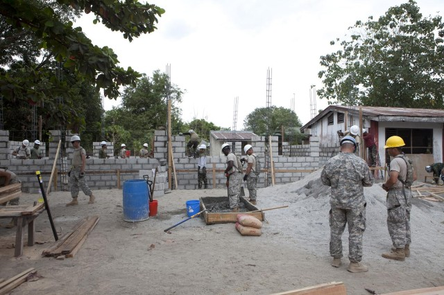 U.S. Soldiers from the 643rd Engineer Company, 8th Theater Sustainment Command, build a classroom at Angel C. Manglicmot Memorial Elementary School, Zambales Province, Republic of the Philippines, March 14, during the preliminary phase of Balikatan 2011.