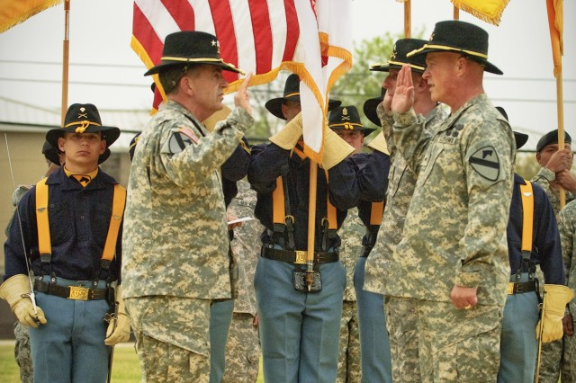 FORT HOOD, Texas-General Peter Chiarelli (left), current Vice Chief of Staff of the Army, gives the oath of office to Brig. Gen. Gary Volesky, deputy commanding general of maneuver, and Brig. Gen. James Richardson, deputy commanding general - support, March 28, on Fort Hood's Cooper Field.