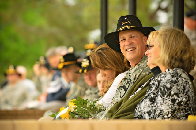 FORT HOOD, Texas-Having just pinned on his first star, South Carolina native,  Brig. Gen. James Richardson, 1st Cavalry Division's deputy commanding general - support,  returns to his seat to rejoin his family March, 28.