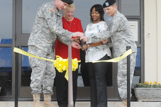 Maj. Gen. Robert Brown, Fort Benning commanding general, and Command Sgt. Maj. Chris Hardy, cut the ribbon opening the Survivor Outreach Services center March 22 with the help of surviving family members Sue Peney and Andrea Jones.