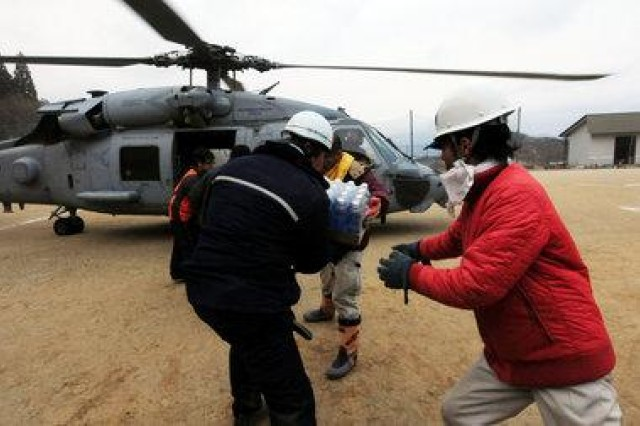 Japanese citizens move food and water out of a HH-60H Sea Hawk helicopter March 15 following the March 11 9.0-magnitude earthquake and tsunami that devastated the country. The Sea Hawk, assigned to the Navy's Black Knights, Helicopter Anti-Submarine Squadron, is conducting search and rescue operations and resupply missions as directed in support of Operation Tomodachi in northern Japan. The Navy's Sea Hawk program is supported indirectly by the Utility Helicopters Project Office.
