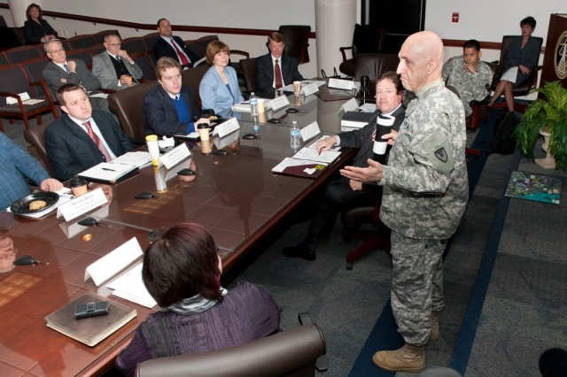 APG senior commander Maj. Gen. Nick Justice talks with staff from Maryland's Congressional delegation March 30 at Aberdeen Proving Ground, Md.