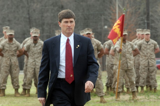 Alabama Sen. Bill Holtzclaw, a retired Marine war veteran, walks away from the Marine Corps Detachment on Redstone Arsenal's parade field during the detachment's recent deactivation ceremony. Holtzclaw, who once commanded the detachment as the officer-in-charge, was the guest speaker at the ceremony. The detachment is moving to Fort Lee, Va., with the Ordnance Munitions and Electronics Maintenance School as part of BRAC 2005.