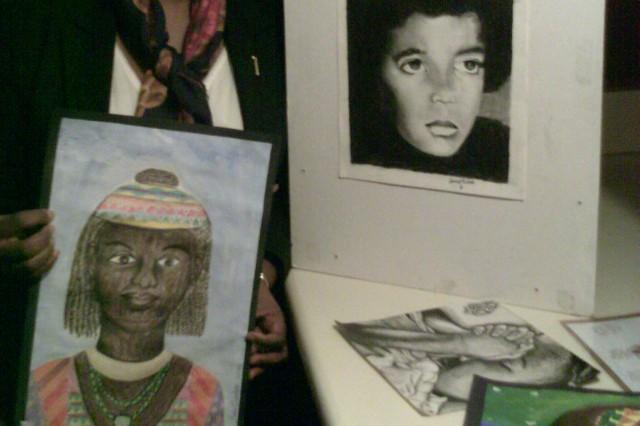 Rosie Douglas displays some of the student artwork.