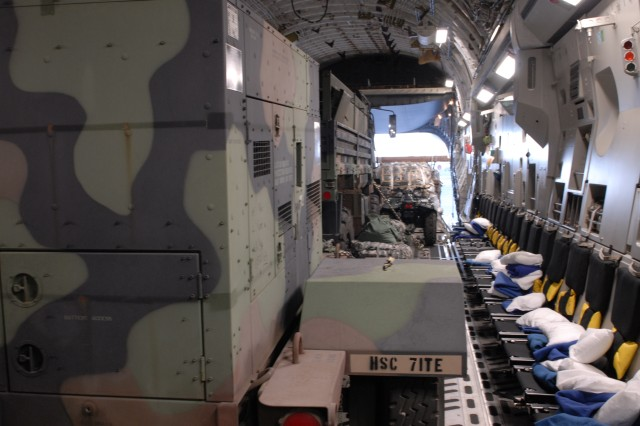 A C-17 at Joint Base Pearl Harbor-Hickam, Hawaii, holds cargo needed by the U.S. Army Pacific Contingency Command Post. The National Guard aircrew will fly both CCP personnel and equipment to the Republic of the Philippines for participation in exercise Balikatan 2011. The USARPAC CCP is a scalable command post designed to rapidly deploy.