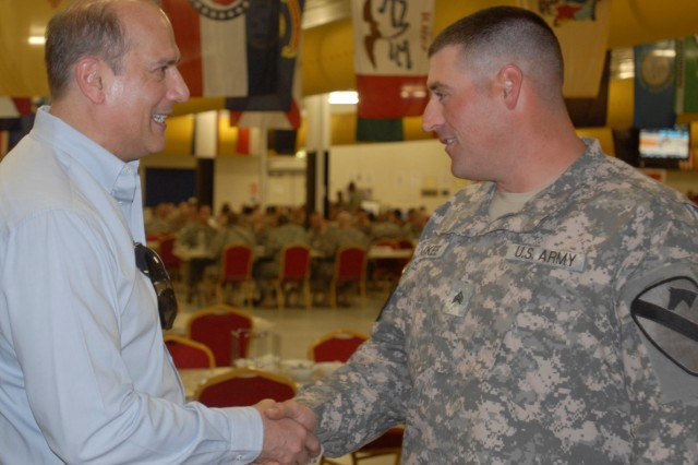 CONTINGENCY OPERATING BASE BASRAH, Iraq - Sgt Philip McKee, a tanker in A Company, 1st Battalion, 12th Cavalry Regiment, 3rd Advise and Assist Brigade, 1st Cavalry Division, of Doylestown, Pa., is greeted by Rep. Thomas Marino, R-Pa. before a congressional delegation luncheon in Basrah, Iraq.