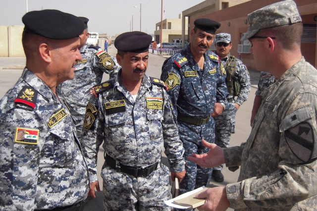 BAGHDAD-Lt. Col. Cameron Cantlon (right), the commander of 6th Squadron, 9th Cavalry Regiment, 2nd Advise and Assist Brigade, 1st Infantry Division, United States Division - Center, discusses with Staff Maj. Gen. Baha'a, the commander of the 4th Federal Police, areas in which Saber Squadron can assist the 4th Federal Police.