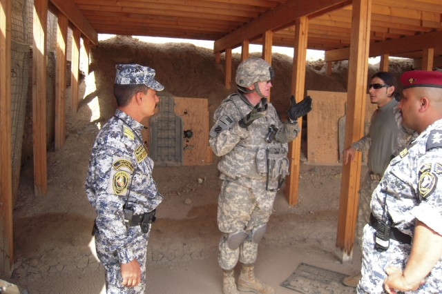 BAGHDAD-Command Sgt. Maj. Richard Burnette (center) of 6th Squadron, 9th Cavalry Regiment, 2nd Advise and Assist Brigade, 1st Infantry Division, United States Division - Center, inspects a weapon range used by the 4th Federal Police
