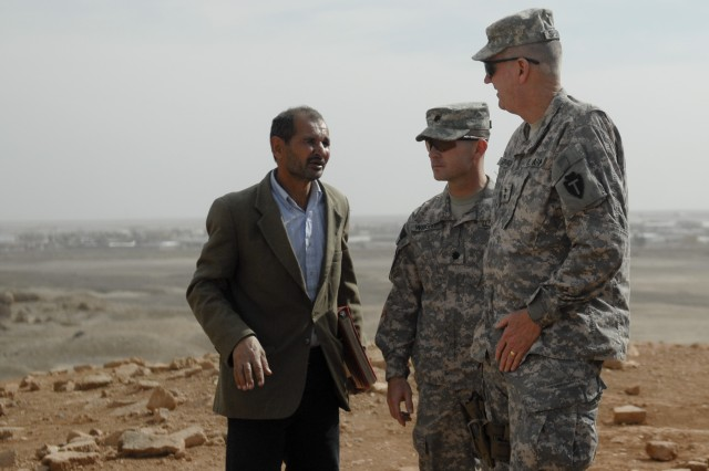CONTINGENCY OPERATING BASE ADDER, Iraq - Maj. Gen. Eddy Spurgin (right), the commander of the 36th Infantry Division and United States Division - South, and Lt. Col. Robert Wright, commander of 2nd Battalion, 82nd Field Artillery Regiment, 3rd Advise and Assist Brigade, 1st Cavalry Division tour the Ziggurat of Ur March 16 as part of a visit.. The battalion operates around the ziggurat and often hosts VIP visits to the monument.