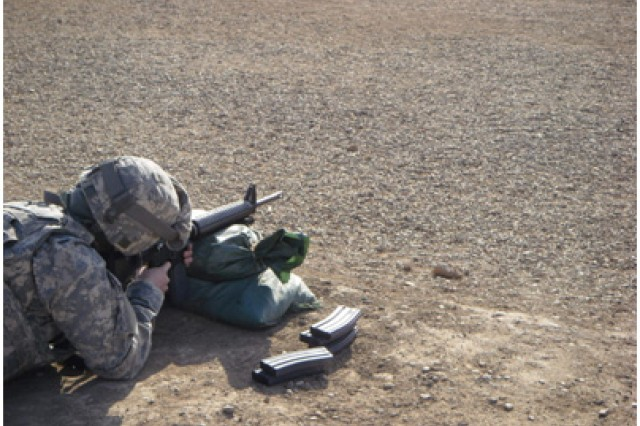 Specialist Karissa Fussell, an operating room specialist with the 632nd Maint. Co., 749th Combat Sustainment Support Battalion, 4th Sustainment Brigade, 103rd Sustainment Command (Expeditionary), and a Gardiner, Maine native, fires her weapon at the range on Contingency Operating Base Adder, Iraq, March 10.