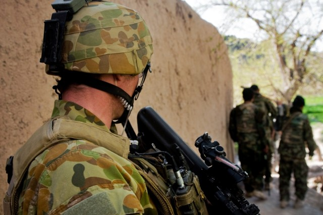 TANGI VALLEY, Afghanistan--Afghan National Army soldiers patrol in Tangi Valley, Afghanistan, March 23, as one of their Australian Army mentors from Combat Team C, 5th Battalion, The Royal Australian Regiment looks on. (U.S. Army Photo by Spc. Edward A. Garibay, 16th Mobile Public Affairs Detachment)