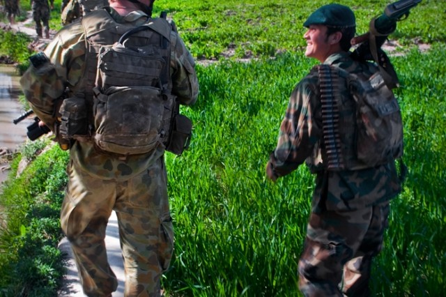 TANGI VALLEY, Afghanistan--An Afghan National Army soldier speaks to one of his Australian Army mentors from Combat Team C, 5th Battalion, The Royal Australian Regiment, while returning to Patrol Base Qareb, Afghanistan, after a patrol March 23. (U.S. Army Photo by Spc. Edward A. Garibay, 16th Mobile Public Affairs Detachment)