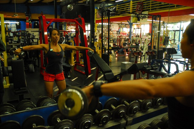 First Lt. Sophie Hilaire performs lateral raises at a local gym Tuesday morning while training for the Death Race. The 24-hour event is an extreme adventure race in which Hilaire will compete in June.