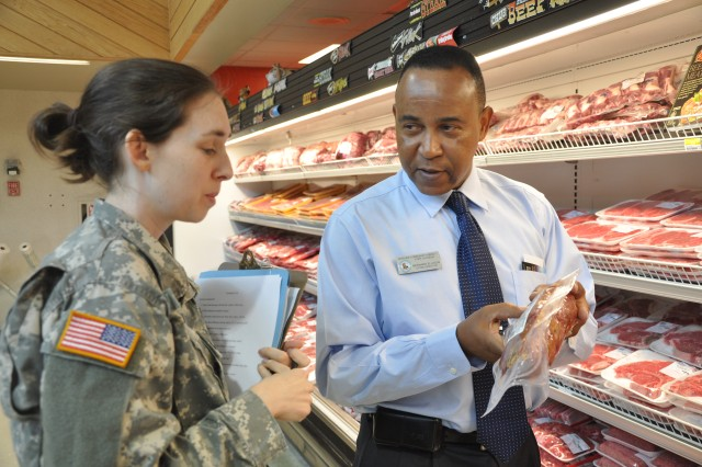 Capt. Emily Smith, chief of Clinical Dietetics at Moncrief Army Community Hospital, speaks with Bernard Ellison, Commissary director, during a tour Friday. The meat department was just one section in which Smith pointed out healthier choices for those trying to lose or maintain their weight.