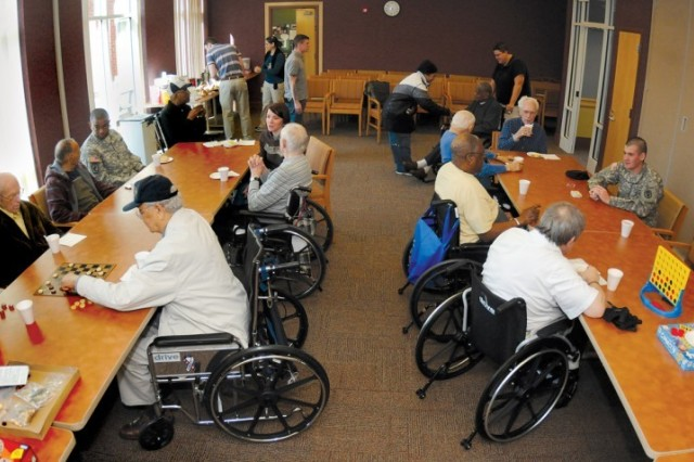 BOSS members play board and card games with residents of the Sitter and Barfoot Veterans Care Center. BOSS members visited the Richmond facility as part of their community outreach program March 29.